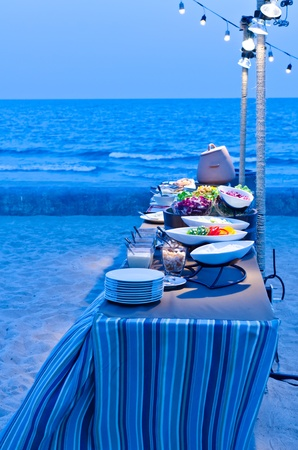 Buffet Table set up with food in twilight time Stock Photo