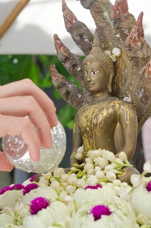 water pouring to Buddha statue in Songkran festival tradition of thailand Stock Photo