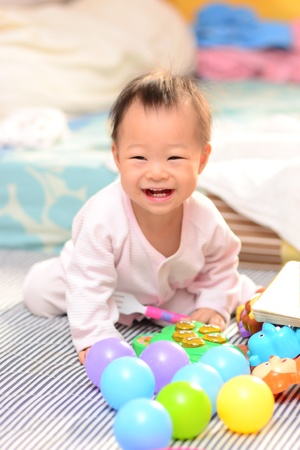 a shot of a cute asian baby girl