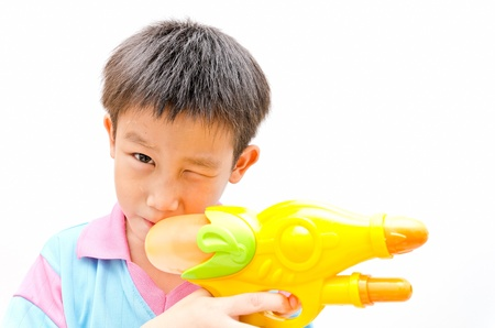 Young Asian boy with water gun photo