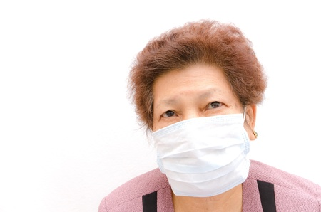 ah1n1: Portrait of Asian senior woman with protective mask isolated on white background Stock Photo