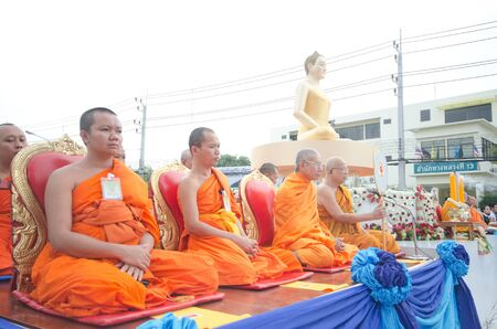 HUA HIN , THAILAND - APRIL 28: Monks waiting for people give food offerings on April 28, 2012  Hua Hin, Thailand. Thai traditional Ceremony: BuddhaJayanti 2600 years, Hua Hin's Anniversary 101 years Stock Photo - 13365347