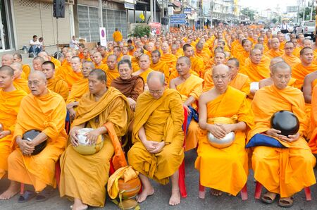 harity event: HUA HIN , THAILAND - APRIL 28: Monks waiting for people give food offerings on April 28, 2012  Hua Hin, Thailand. Thai traditional Ceremony: BuddhaJayanti 2600 years, Hua Hins Anniversary 101 years