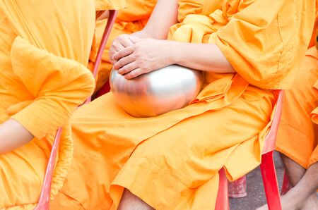 harity event: HUA HIN , THAILAND - APRIL 28: Monks waiting for people give food offerings on April 28, 2012  Hua Hin, Thailand. Thai traditional Ceremony: BuddhaJayanti 2600 years, Hua Hin