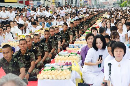 harity event: HUA HIN , THAILAND - APRIL 28: People Gives food offerings to a Buddhist monk on April 28, 2012 Hua Hin, Thailand. Thai traditional, The occasion BuddhaJayanti 2600 years
