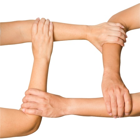 Human hands holding each other showing unity, isolated on white background photo