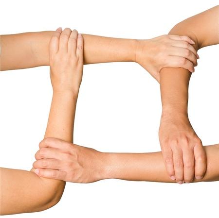 Menschliche Hände halten einander Vorführung Einheit, isoliert auf weißem Hintergrund