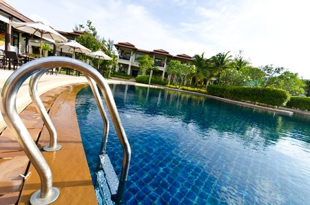 Landscape with pool views and house Stock Photo - 13537980
