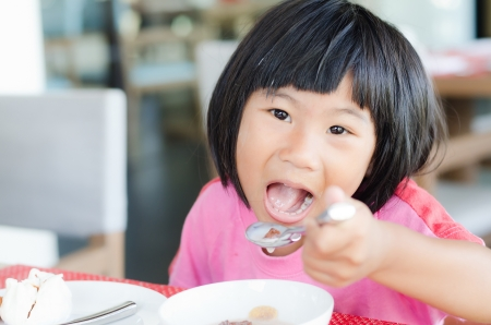Asian girl enjoy her breakfast photo