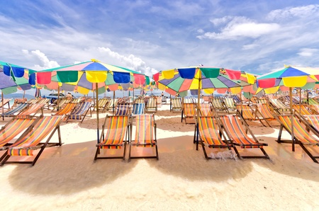 Beach chair and colorful umbrella on the beach in sunny day, Phuket Thailand