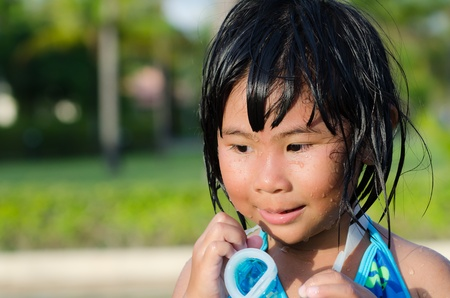 damping: Cute Asian girl with wet hair and body Stock Photo