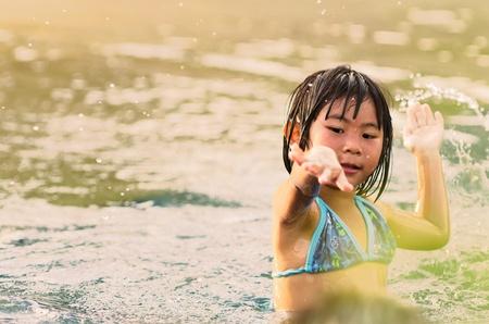 Portrait of Cute asian girl who is enjoy swim