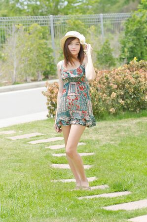 approachable: Portrait of an attractive Asian woman in the garden Stock Photo