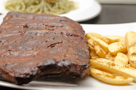 Pork ribs back with french fries photo