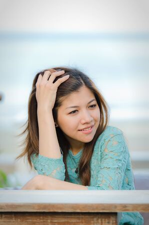 Attractive Asian woman with smiling on the beach photo