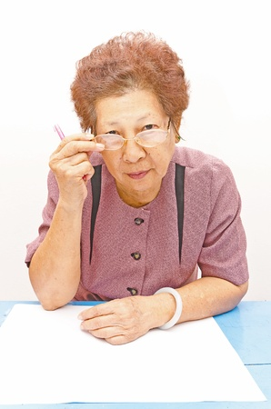 Happy smiling retired lady wearing  glasses photo