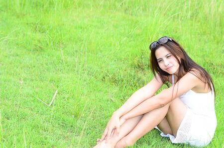 Young Asian Woman on green field photo