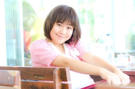 Cute ASian teenager girl and her IPAD photo