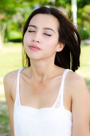 Relaxing Asian woman in the park Stock Photo - 14063319