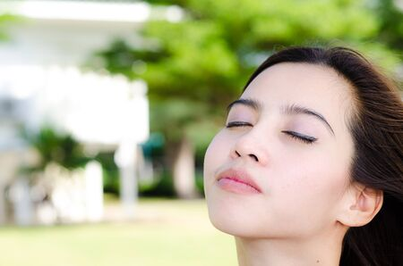 preasure: Relaxing Asian woman in the park