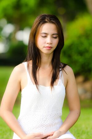 Beautiful healthy Young Woman meditating on the green grass Stock Photo - 14063316