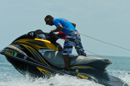 hn: HUAHIN, THAILAND - JUNE 24 : Unidentified rider pumps up his machine during HuaHin Jet Ski Racing Championships on June 24, 2012 in Hua Hin, Thailand