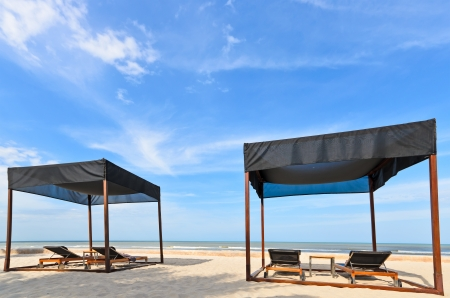Couple of beach tent with lounge chairs Stock Photo - 14183548