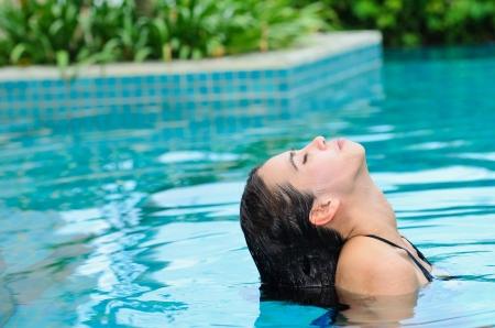 diving pool: Asian woman in swiming pool Stock Photo