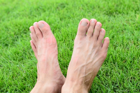 bare: Foot over green grass