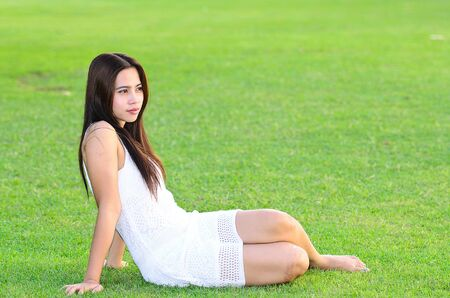 Beautiful young Asian woman on the green  photo