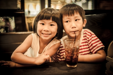 pre adolescent boys: children eating together  Stock Photo