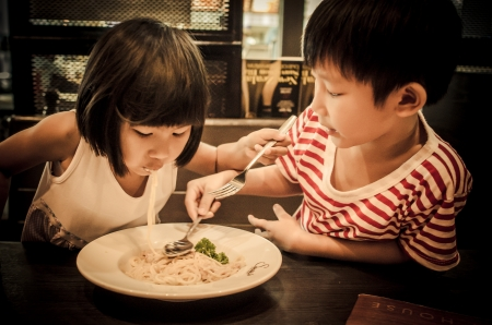 children eating together  photo