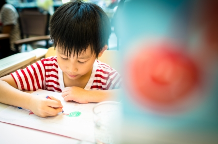 Asian boy painting Stock Photo