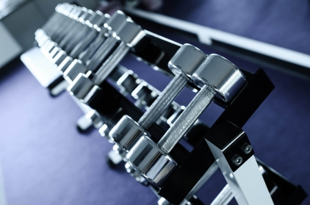 Weights, many black dumbbell in fitness room Stock Photo