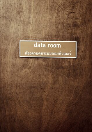Woodern door with data room board process in vintage style photo