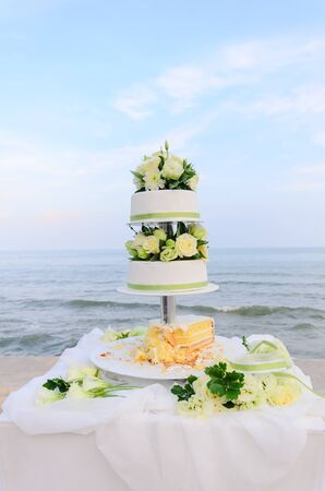 Wedding cake and the sea photo