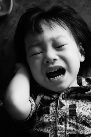 Kid crying black and white photo