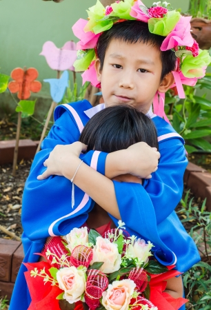 Cute boy in a graduation gown. Education photo