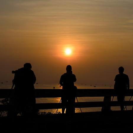 photographers taking sunrise photo on the bridge with silouette Stock Photo - 19032499