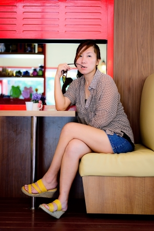 Asian woman waiting in a coffee shop photo