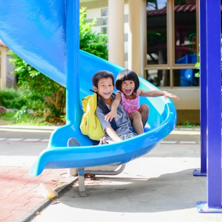 asian youth: Asian brother and sister enjoy playground Stock Photo