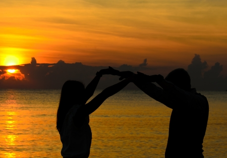 Couple of lover holding hand with sun rise photo