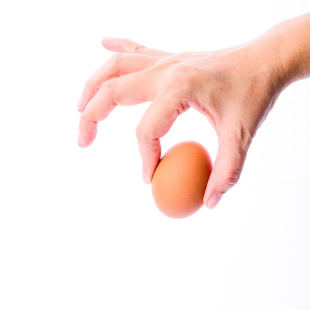 Woman hand with eggs isolated on white background photo