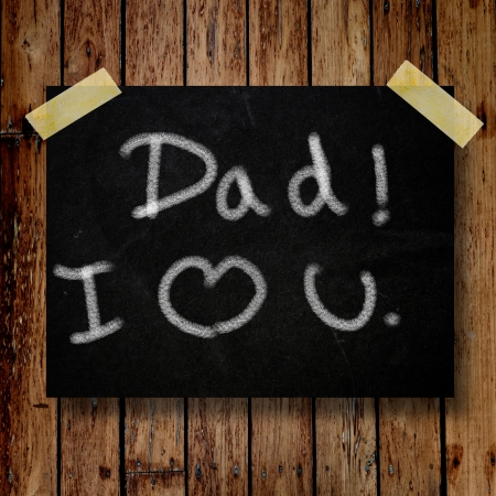 Happy Father Day note on message note with wooden background 版權商用圖片