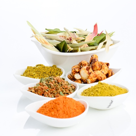 Lemongrass, cashew nut, chilli powder and Thai herb on the bowl isolated on white background