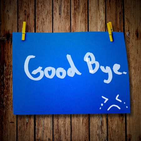 miss you: Good bye note paper and clothes peg on a wooden background with smile face