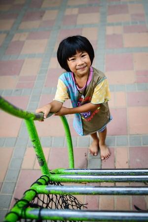 Happy Asian girl on playground photo