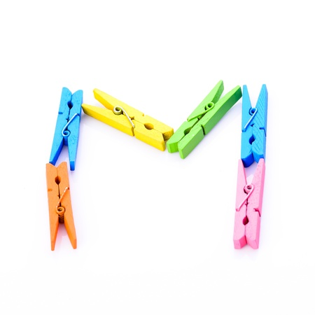 Cloth pins in ABC alphabet shape photo