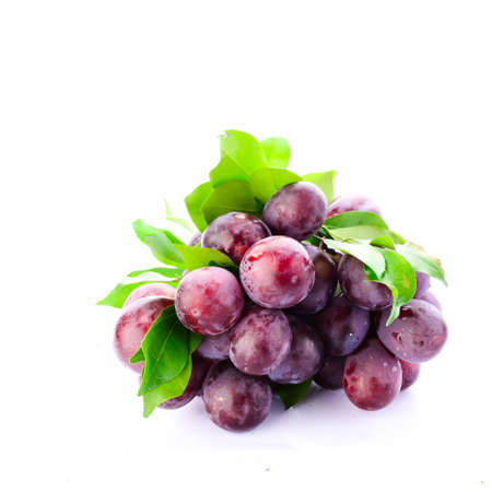 Fresh red grapes isolated on white background. photo