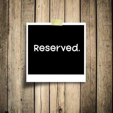 Reserved message  grunge wooden background with copy space photo